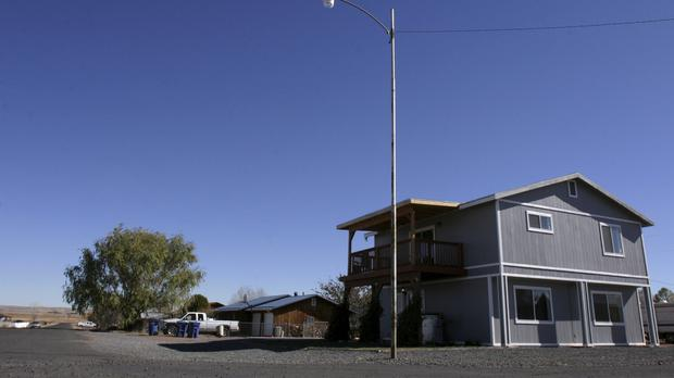 The house in St. Johns, Arizona, where Vincent Romero and Timothy Romans were found fatally shot. (AP Photo/Dana Felthauser, File)