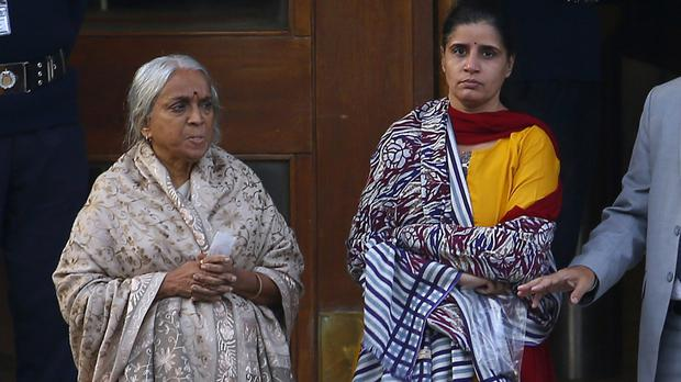 The mother and wife of imprisoned Indian naval officer Kulbhushan Jadhav in Islamabad, Pakistan (Anjum Naveed/AP)