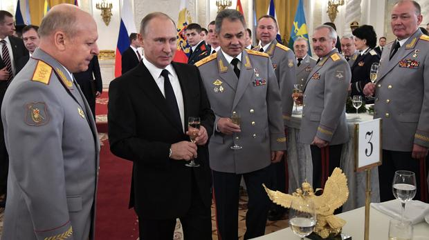 Vladimir Putin at an awards ceremony in the Kremlin for troops who fought in Syria (Alexei Nikolsky, Sputnik, Kremlin Pool Photo via AP)