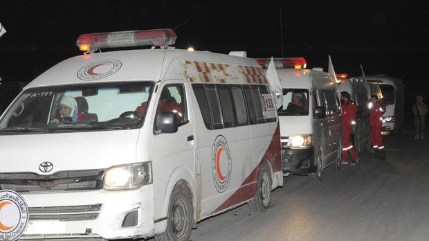 Syrian Arab Red Crescent ambulances during a mission to evacuate sick and wounded people from eastern Ghouta, near Damascus (Sana via AP)