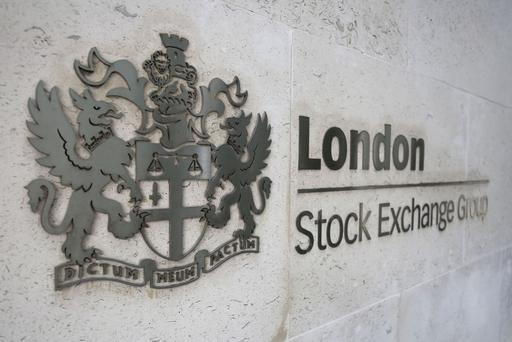 Britain's FTSE 100 ended at a new record high, up 0.9pc. (PA)
