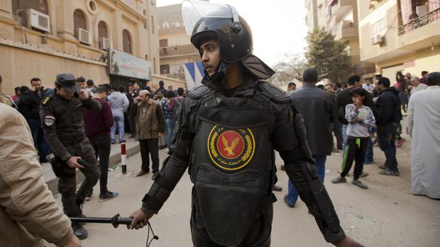 A policeman stands guard in front of Mar Mina church in Cairo, Egypt after several people were killed by a gunman (AP Photo/Amr Nabil)