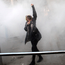 THE FOG OF PROTEST: An Iranian woman raises her fist amid the smoke of tear gas at Tehran University yesterday. Photo: Getty Images