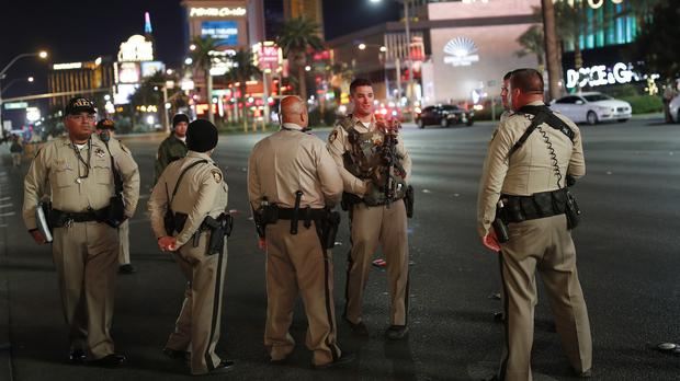 Las Vegas police officers stand along the Las Vegas Strip (AP)