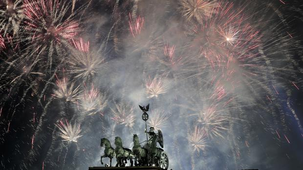 Fireworks light up the sky above the Quadriga at the Brandenburg Gate during new year's celebrations in Berlin (Markus Schreiber/AP)