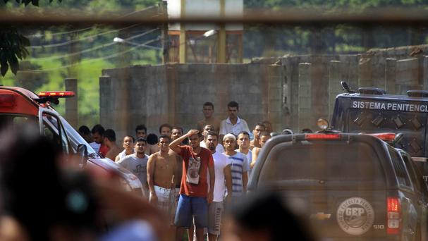 Prisoners, back, try to contact relatives after a rebellion at the Colonia Agroindustrial prison in the state of Goias, Brazil (Claudio Reis/O Popular/AP)