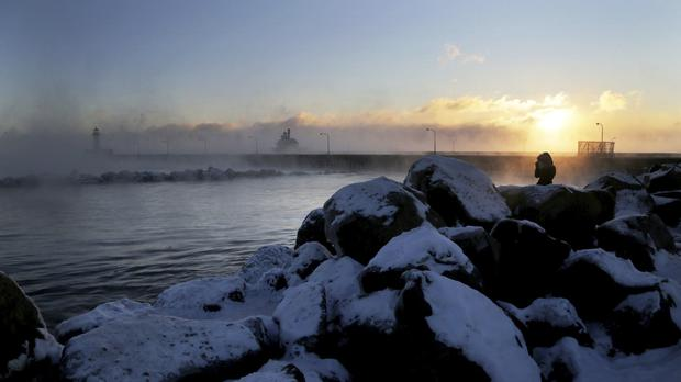 The sun rises on Lake Superior in Duluth, Minnesota (Star Tribune/AP)