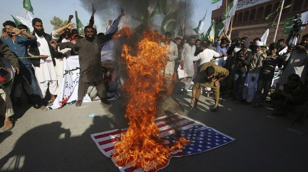 Supporters of Pakistani religious groups condemn the tweet by Donald Trump in Karachi (AP)