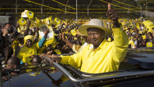 Yoweri Museveni waves to supporters at a 2016 election rally in Kampala (AP)