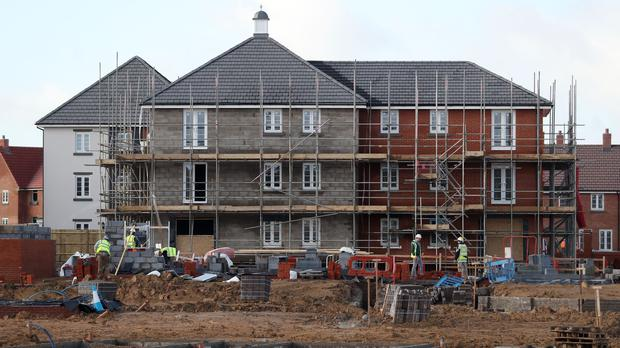 Houses under construction on a new housing development (PA)