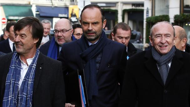 Mr Philippe, centre, called for those responsible to be caught (AP)