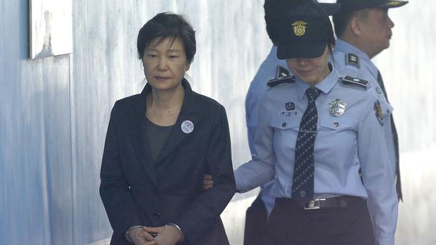 Former South Korean president Park Geun-hye, left, faces further bribery charges (AP Photo/Ahn Young-joon, File)