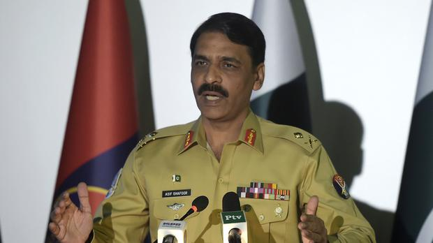 Pakistan's army spokesman Major General Asif Ghafoor addresses a news conference in Rawalpindi (AP)