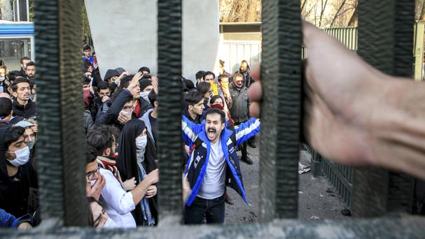 University students at an anti-government protest in Iran (AP)