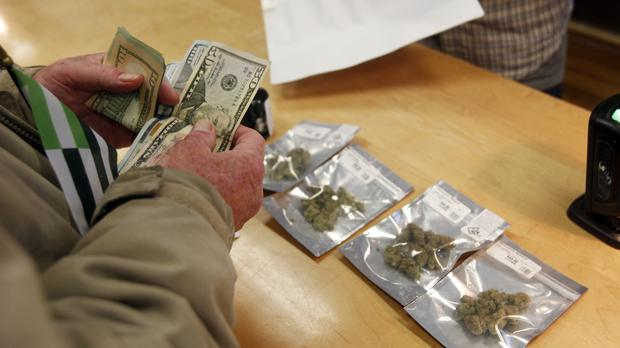 A customer purchases marijuana at Harbourside marijuana dispensary in Oakland, California (AP)