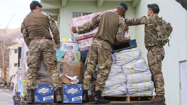 Members of the armed forces preparing aid for distribution ahead of Hurricane Maria (L(Phot) Joel Rouse/MoD Crown Copyright/PA)