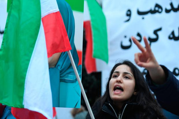 A supporter of Iran's main opposition outside the Iranian embassy in London. Photo: PA