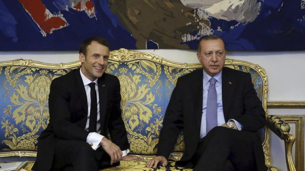 Emmanuel Macron and Recep Tayyip Erdogan pose for a photo before a meeting at the Elysee Palace in Paris (AP)