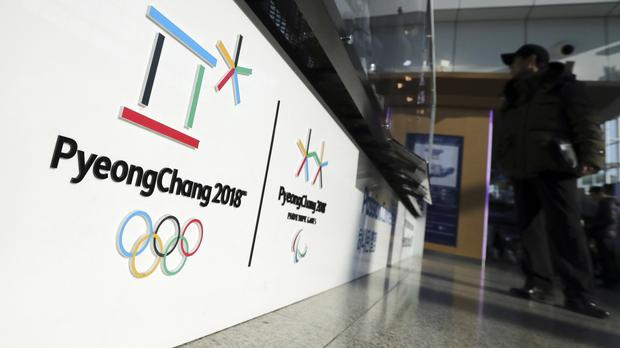 The official emblems of the 2018 Pyeongchang Olympic and Paralympic Winter Games are seen at the Seoul Train Station (AP)