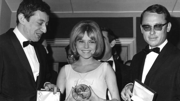 France Gall, singing for Luxembourg in the Eurovision Song Contest, poses with her award with Serge Gainsbourg, left, and orchestra director Alain Gorauguer (AP/Guilio Broglio)