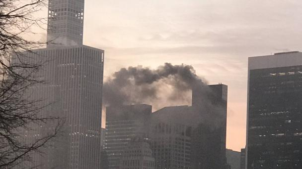 Photo taken with permission from the twitter feed of @SusanSball4 of smoke coming from Trump Tower in Manhattan, New York, USA