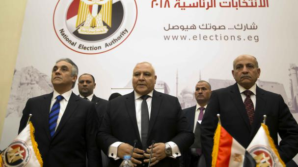 The Egyptian National Electoral Commission also announced that the presidential run-off will take place in April (AP)