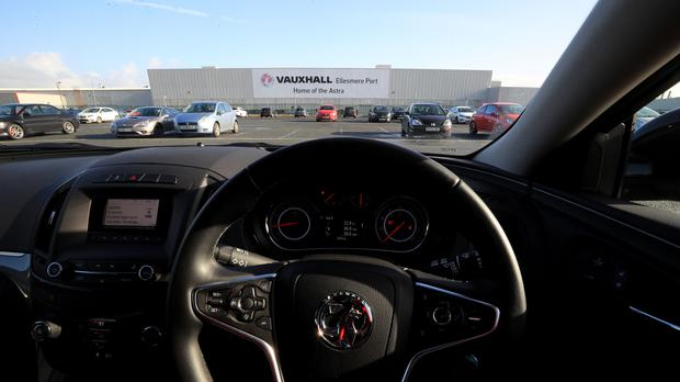 A Vauxhall car parked outside the Vauxhall plant in Ellesmere Port, Cheshire (PA)