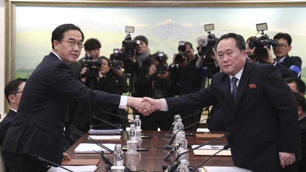 The heads of the South and North Korean delegations shake hands after their meeting at Panmunjom (Yonhap/AP)