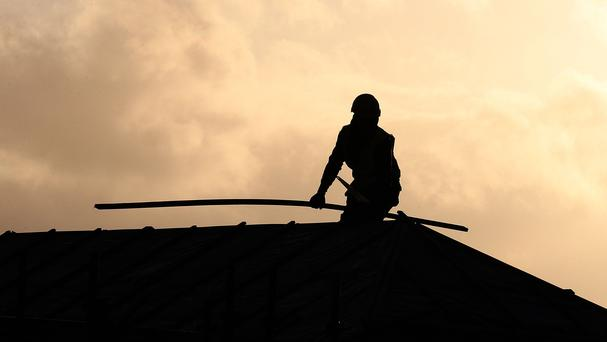 A roofer works, as Barratt Developments updates on its financial performance (PA)