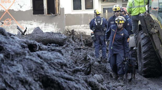 Emergency workers search areas damaged by mudslides in California (AP Photo/Marcio Jose Sanchez)