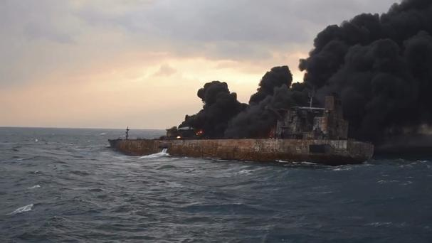Smoke rises from a fire on board the oil tanker Sanchi in the East China Sea (Ministry of Transport via AP)