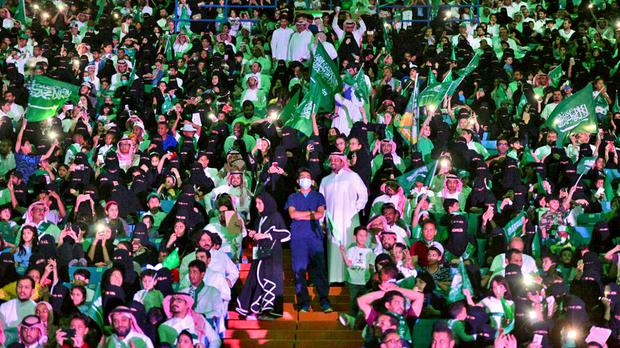 Saudi men and women attend national day ceremonies at the King Fahd stadium in Riyadh last year (Saudi Press Agency via AP)
