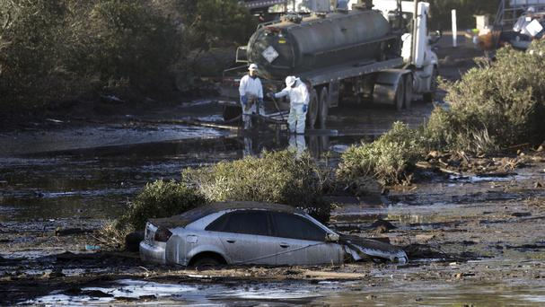Crews pump mud on Highway 101 after a mudslide in Montecito (Marcio Jose Sanchez/AP/PA)
