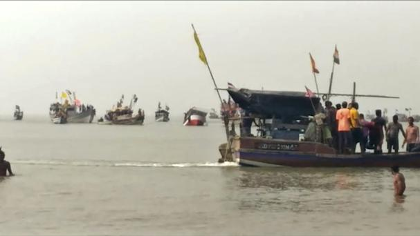 A video screen grab shows rescuers looking for survivors and bodies of victims in the Arabian Sea in Dahanu (KK Productions/AP/PA)