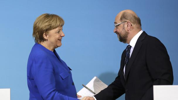 Chancellor Angela Merkel and Social Democratic Party Chairman Martin Schulz (AP)