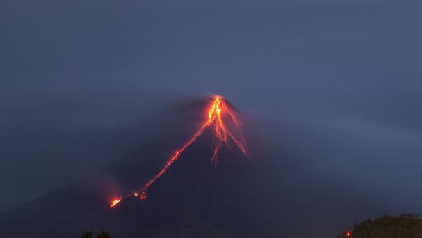 Lava continues to cascade down the slopes of the volcano (AP)