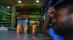 A Sri Lankan man purchases alcoholic beverages at a liquor shop in Colombo (AP Photo/Eranga Jayawardena)