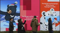Posters showing the 2018 Pyeongchang Winter Olympic mascots in Seoul (AP)