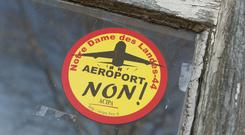 "A sticker reading ""No to the airport"" is pasted on the window of a farm (AP)"