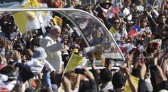 Pope Francis arrives on the popemobile to the Maquehue Air Base (AP)
