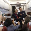 Flight attendants Carlos Ciuffardi and Paola Podest (Alessandra Tarantino/AP)