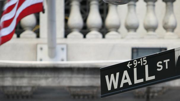 A sign for Wall Street in New York's financial centre (Martin Keene/PA)