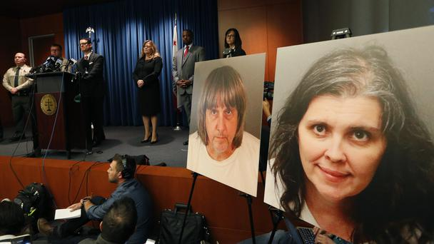 David and Louise Turpin's pictures at a press conference (AP Photo/Damian Dovarganes)