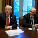 US President Donald Trump gestures next to Chief of Staff John Kelly at the White House in October. Photo: Reuters