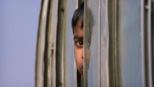 A Rohingya refugee boy among those being relocated from a camp near the Bangladesh-Burma border (AP)