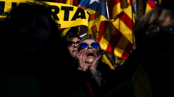 People gather outside the Catalonia parliament (AP)