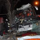 Rescue workers attend the crash (DHA-Depo Photos/AP)