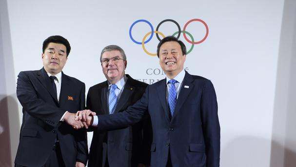IOC, President Thomas Bach with North Korea's Olympic Committee President and sports minister Kim Il Guk, left, and South Korea's Sports Minister Do Jong-hwan (Laurent Gillieron/Keystone/AP)