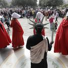 Texas Handmaids lead a women's march to the Texas State Capitol (AP)