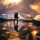 A protester walks under a huge EU flag (AP)
